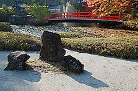 Zen Garden by the Lotus Pond at Garan, the sacred complex of temple buildings in Koyasan.  The pond is crossed by a red bridge with a small island called Hasu-ike, the pond of lotus.  It is said that the a good-natured female dragon queen, Nagirajni, appeared in the Lotus Pond after a local priest, Monk Jiko of Zuisoin Monastery invited the dragon to the tiny island in the middle of the pond to help bring water during a time of severe drought.