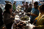 The busiest place in town come morning time in Muang Sing is the local market.