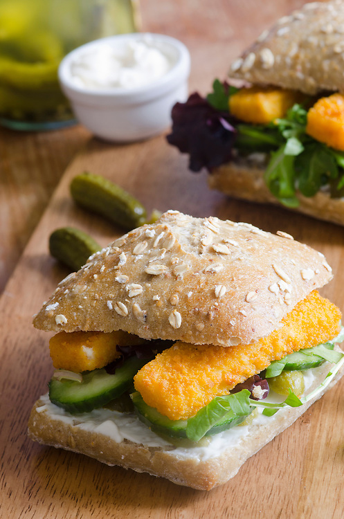 Ciabatta filled with golden fish fingers and salad