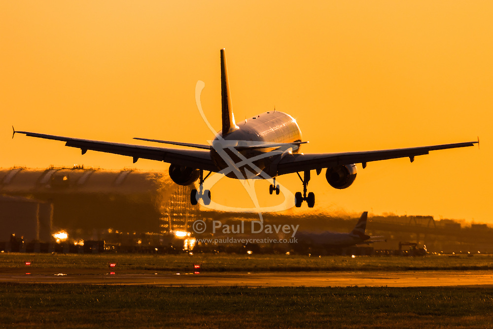 An Airbus A320 lands at London's Heathrow Airport (LHR / EGLL).