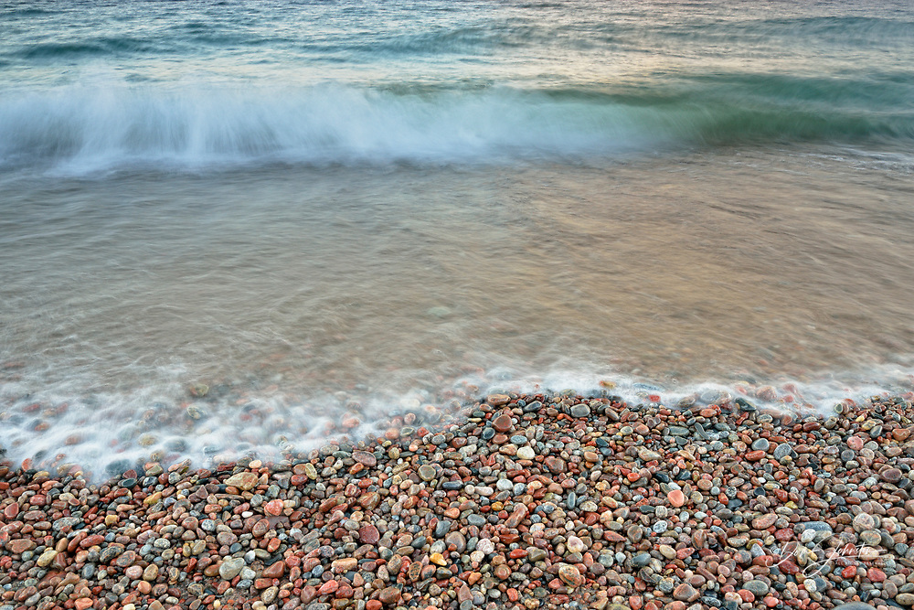 Beach pebbles on the shore of Agawa Bay with surf, Lake Superior Provincal Park, Ontario, Canada