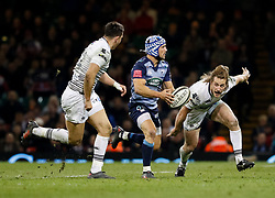 Cardiff Blues' Matthew Morgan evades the tackle of Ospreys' Jeff Hassler<br /> <br /> Photographer Simon King/Replay Images<br /> <br /> Guinness PRO14 Round 21 - Cardiff Blues v Ospreys - Saturday 28th April 2018 - Principality Stadium - Cardiff<br /> <br /> World Copyright © Replay Images . All rights reserved. info@replayimages.co.uk - http://replayimages.co.uk