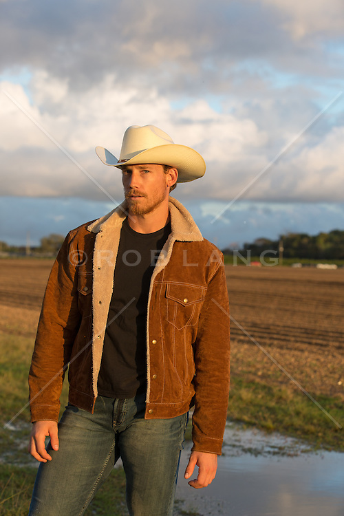 rugged cowboy with a beard outdoors