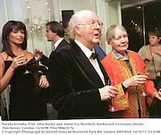 Natalia Estrada, Prof. John Bayley and  Dame Iris Murdoch, Duckworth Centenary Dinner. Dorchester, London. 14/10/98. Film 98861f17a<br />© Copyright Photograph by Dafydd Jones<br />66 Stockwell Park Rd. London SW9 0DA<br />Tel 0171 733 0108