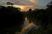 Sunset reflects in the Tiputini River...Tiputini Biodiversity Station, Amazon Rain Forest, Ecuador.