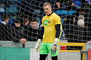 Craig MacGillivray of Portsmouth warms up during the EFL Sky Bet League 1 match between Wycombe Wanderers and Portsmouth at Adams Park, High Wycombe, England on 6 April 2019.