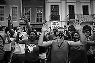 """Hundreds gathered for a vigil for Mark Brown and a protest in solidarity with the people of Ferguson Missouri, part of a 'Day of Rage' in New Orleans on Aug. 14th at 6 pm.<br /> After the vigil they took to the streets and marched to the police station on Royal Street. Before entering the lobby and holding an impromptu rally they chanted  """"hands up, don't shoot,"""" in front of the station;s entrance"""
