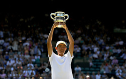 Chun Hsin Tseng holds up the trophy after winning the Boys' singles final on day thirteen of the Wimbledon Championships at the All England Lawn Tennis and Croquet Club, Wimbledon. PRESS ASSOCIATION Photo. Picture date: Sunday July 15, 2018. See PA story TENNIS Wimbledon. Photo credit should read: Steven Paston/PA Wire. RESTRICTIONS: Editorial use only. No commercial use without prior written consent of the AELTC. Still image use only - no moving images to emulate broadcast. No superimposing or removal of sponsor/ad logos. Call +44 (0)1158 447447 for further information.
