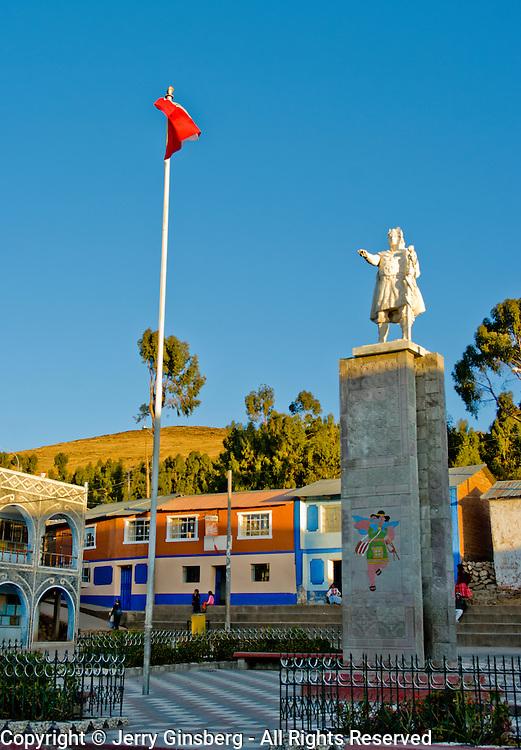 Statue of Inca chief dominates the main plaza on the island of Amantani in Lake Titicaca, Peru.