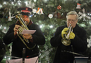 Newburgh, New York  - Two members of a Salvation Army band play music in front of the tree during the Christmas tree lighting ceremony on Broadway on the night of Dec. 14, 2011.