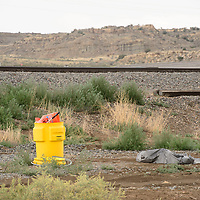 A salvage drum, used for the storage, handling and transportation of hazardous materials, sits near the railroad tracks behind Virgie's Restaurant and Lounge on Historic Highway 66 where a rail car detailed Tuesday.