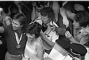 1983-15-08.15th August 1983.15-08-1983.08-15-83..Photographed at Dublin Airport..Pressed:..Eamonn Coughlan with his wife Yvonne receive the adulation of wellwishers on his return from the World Athletic Championships in Helsinki, Finland.