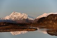 The Chugach Mountains reflected in a pond near Valdez, Alaska
