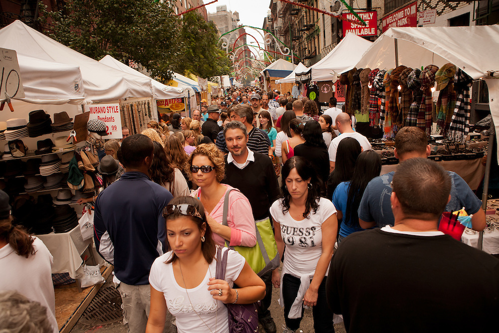 New York, NY -24 September 2011. The feast of San Gennaro in New York's Little Italy. Crowds thread their way through Mulberry Street, which is lined with vendors.