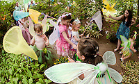 """Maggie Newton,  Jane Kelley and Anne Kelley wander through the """"Butterfly Garden"""" during Cackleberries Fairy Princess Night in Meredith on Wednesday evening.  (Karen Bobotas/for the Laconia Daily Sun)"""