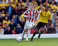 Photo: Leigh Quinnell.<br /> Watford v Sheffield United. Coca Cola Championship.<br /> 17/09/2005. Sheffield Uniteds Alan Quinn sheilds the ball from Watfords Ashley Young.