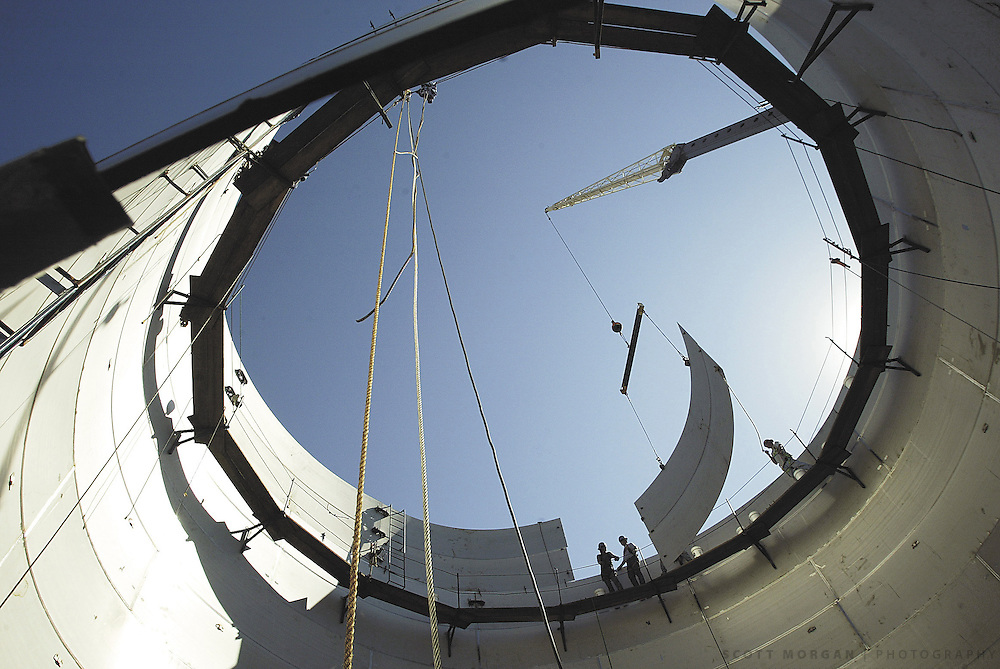 Scott Morgan/The Hawk Eye.Workers from Winbco Tank Company out of Ottumwa put a steel sheet in place on a 735,000-gallon fermintation tank Tuesday, Sept. 23, 2003. There are three tanks at the site where cooked ethanol is fermented for two days before moving on in the process.
