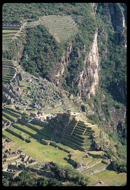 Intihuatana pyramid, main quarry & terraces stand out in view from Huayna Picchu; Machu Picchu Peru