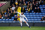 Jason Naismith of Peterborough United tackles Jordan Graham of Oxford United during the EFL Sky Bet League 1 match between Oxford United and Peterborough United at the Kassam Stadium, Oxford, England on 16 February 2019.