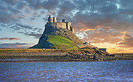 Lindisfarne Castle at sunset- 16th Century castle, Holy Island, Lindisfarne, Northumberland, England .<br /> <br /> Visit our ENGLAND PHOTO COLLECTIONS for more photos to download or buy as wall art prints https://funkystock.photoshelter.com/gallery-collection/Pictures-Images-of-England-Photos-of-English-Historic-Landmark-Sites/C0000SnAAiGINuEQ