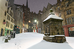 Edinburgh, Scotland, UK. 10 Feb 2021. Big freeze continues in the UK with heavy overnight and morning snow in the city. Pic;  Victoria Street at West Bow empty in the early morning snow. Iain Masterton/Alamy Live news