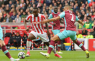Sadio Berahino of Stoke battles with Winston Reid of West Ham .Premier league match, Stoke City v West Ham Utd at the Bet365 Stadium in Stoke on Trent, Staffs on Saturday 29th April 2017.<br /> pic by Bradley Collyer, Andrew Orchard sports photography.