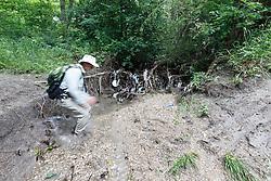 Hiker in creek near  Scyene Overlook, Great Trinity Forest, Dallas, Texas, USA