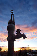 An old water pump in a field near Crescent, Oklahoma