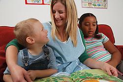 Nursery nurse with children