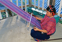 Woman Using Loom