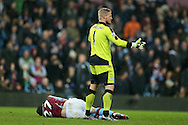 Leicester city goalkeeper Kasper Schmeichel looks on at Libor Kozak of Aston Villa (on ground) after Robert Huth of Leicester city had brought the Villa player down in the penalty area but no penalty is awarded. Barclays Premier league match, Aston Villa v Leicester city at Villa Park in Birmingham, The Midlands on Saturday 16th January 2016.<br /> pic by Andrew Orchard, Andrew Orchard sports photography.