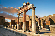 The Roman Corinthian Porticus, columns & tables of the money changers at the entrance of the Macellum in the Forum of Pompeii archaeological site, Italy. .<br /> <br /> If you prefer to buy from our ALAMY PHOTO LIBRARY  Collection visit : https://www.alamy.com/portfolio/paul-williams-funkystock/pompeii.html<br /> Visit our CLASSICAL WORLD HISTORIC SITES PHOTO COLLECTIONS for more photos to buy as buy as wall art prints https://funkystock.photoshelter.com/gallery-collection/Classical-Era-Historic-Sites-Archaeological-Sites-Pictures-Images/C0000g4bSGiDL9rw