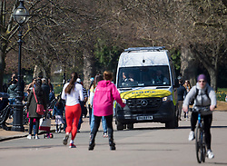 © Licensed to London News Pictures. 04/04/2021. London, UK. Police patrol as members of the public gather in Hyde Park. On April 12th England is set to relax more lockdown restrictions, which were imposed to control the spread of COVID-19. Photo credit: Ben Cawthra/LNP