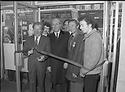 """Opening of New Ogra Fianna Fail office on O'Connell St,Dublin.1982.30.01.1982.01.30.1982.30th January 1982..Photo of Mr Charles Haughey,.Leader of Fianna Fail cutting the ribbon to officially open th new """"Ogra"""" office. He is accompanied by Mr George Colley T.D.,Mr Bertie Ahearn T.D.,Mr Tom Leonard (candidate) and Mr Paul Edgehill a member of Ogra Fianna Fail."""