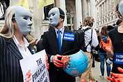 Two faceless financier climate activists from Extinction Rebellion talk to each other outside the Bank of England on 27th August, 2021 in London, United Kingdom. The activist group Extinction Rebellion XR are planning actions of disruption for two weeks straight beginning on August 23rd, 2021 in an effort to bring awareness and priority to the global climate emergency in advance of the COP 26 Summit which will be held in Glasgow later this year.