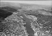 """Ackroyd 02997-02. """"Portland City July 10, 1951"""" (looking downstream on the Willamette River & Portland waterfront from the Broadway bridge.)"""