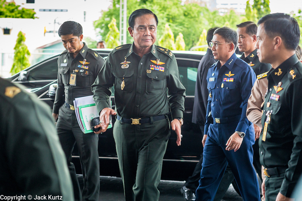 """20 MAY 2104 - BANGKOK, THAILAND:  General PRAYUTH CHAN-OCHA, Commander-in-Chief of the Royal Thai Army, arrives at the Army Club after the declaration of martial law. Gen. Prayuth called members of Thai society to the Army Club to tell them about martial law. The Thai Army declared martial law throughout Thailand in response to growing political tensions between anti-government protests led by Suthep Thaugsuban and pro-government protests led by the """"Red Shirts"""" who support ousted Prime Minister Yingluck Shinawatra. Despite the declaration of martial law, daily life went on in Bangkok in a normal fashion. There were small isolated protests against martial law, which some Thais called a coup, but there was no violence.  PHOTO BY JACK KURTZ"""