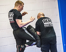 Students using their knees on pads. Stef Noij, KMG Instructor from the Institute Krav Maga Netherlands, takes the IKMS G Level Programme seminar today at the Scottish Martial Arts Centre, Alloa.