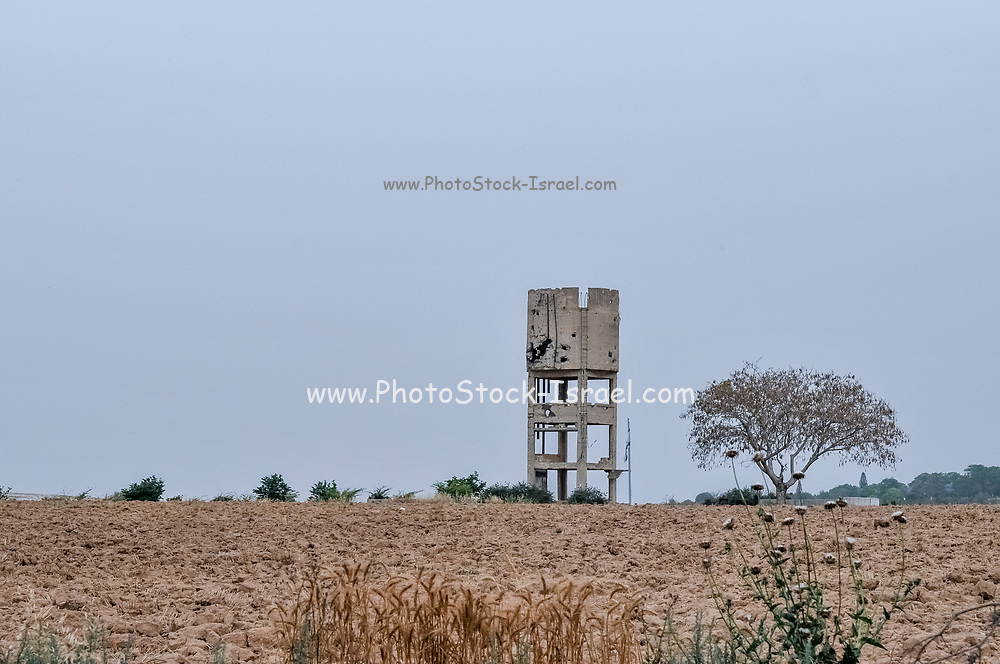 Shot up damaged watertower. Photographed on the Palestinian Israeli border on May 4th 2018