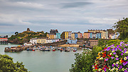 Tenby. The colourfully painted houses around this walled seaside town on the the west side of Carmarthen Bay in Wales. A naturally sheltered harbour this is a strategic harbour that was taken by the Normans in the 12th century.