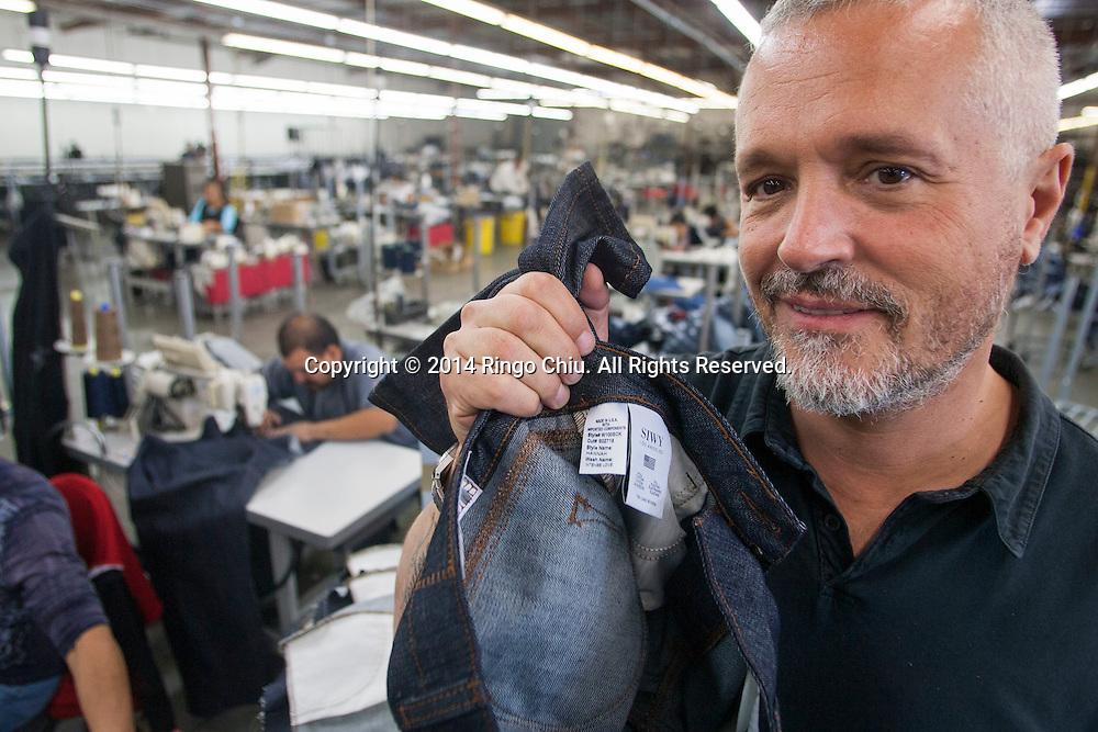 Alain Lafourcade, Chief Operating Officer, of jeans manufacturer, Siwy Denim, Inc., inside the facility.<br /> (Photo by Ringo Chiu/PHOTOFORMULA.com)