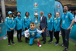Mayor of London Sadiq Khan and volunteers pose for a photograph with the Henri Delaunay Cup, outside King's Cross Station, which made a special visit to London today as part of the UEFA EURO 2020 Trophy Tour. Issue date: Friday June 4, 2021.