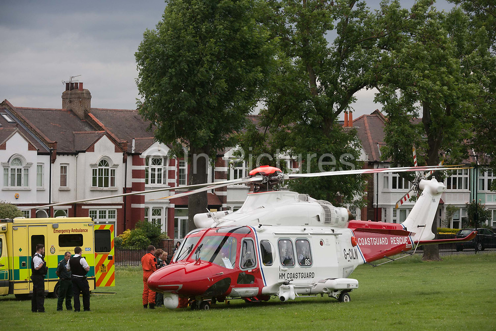 An AgustaWestland AW139 helicopter operated by the UK Coastguard rescue has brriefly landed in Ruskin Park to deliver an emergency patient, on 8th June 2017, in the south London borough of Lambeth, England. The AW139 is used by Her Majestys Coastguard HMCG which is a section of the Maritime and Coastguard Agency responsible for the initiation and co-ordination of all maritime search and rescue SAR within the UK Maritime Search and Rescue Region.