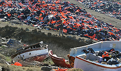 Embargoed to 0001 Monday February 6 British expatriate Eric Kempson, who is battling to save lives on the Greek island of Lesbos, walks between smashed migrant boats and piles of used life jackets which he claims the majority of which are fake and include at least 150,000 vests, half of the original amount that began to accumulate after long trips to the main tip became unsustainable owing to the large influx of refugees and subsequent discarded life jackets, located on the island close to his home in Eftalou, where the 61-year-old warned the refugee crisis is far from over.