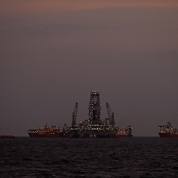 The Transocean Development Driller II and support vessels are seen at the BP Plc Macondo well site in the Gulf of Mexico off the coast of Louisiana, U.S., on Friday, July 30, 2010. BP Plc continues to work on a relief well to permanently plug the source of the largest oil spill in U.S. history.  Photographer: Derick E. Hingle/Bloomberg
