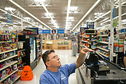 """BIRMINGHAM, AL – JUNE 13, 2015: Matthew Seals, 47, shops at the local Walmart. <br /> <br /> In April 1998, a deadly F5 tornado ripped through the suburbs of Birmingham, Alabama, killing 32 people and destroying hundreds of homes. Seventeen years later, Matthew Seals is still learning to cope with the loss of his youngest son, who was killed in the storm. With help from Habitat for Humanity, Seals completed construction on a new home in 2015, where he continues to raise his remaining children and his new life as a paraplegic. Despite his own suffering from the tragedy, Seals volunteers with Habitat to help other families find their own form of stability through home ownership. """"Habitat gives you an opportunity to help yourself,"""" Seals said. """"Not just for the immediate need, but for the long term to become more self-sufficient, more self-confident, and more self-reliant."""""""