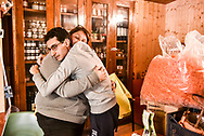 """Ortolani Coraggiosi. Fucecchio (FI). The psychologist Samantha Cantini who runs the Ortolani Coraggiosi project for the synergic coop embraces Francesco Marras, suffering from autism and an integral part of the Cooperative. His shift is ending and he will return home. """"They are people with different characteristics than ours but they are people,"""" says Samantha"""