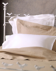 bed with linen sheets