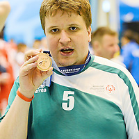 31 January 2013; Team Ireland's James Murphy, from Corbally, Co. Clare, celebrates after the Bronze Medal presentaion ceremony. Ireland beat the host nation, South Korea, in the 3rd / 4th place play off. 2013 Special Olympics World Winter Games, Floorball, Gangneung Indoor Sports Center, Gangneung, South Korea. Picture credit: Ray McManus / SPORTSFILE *** NO REPRODUCTION FEE ***