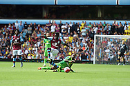 Idrissa Gana of Aston Villa is tackled by Yann M'Vila of Sunderland. Barclays Premier League match, Aston Villa v Sunderland at Villa Park in Birmingham, Midlands on Saturday 29th August  2015.<br /> pic by Andrew Orchard, Andrew Orchard sports photography.